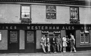 1930s enjoying a pint outside The Old House at Home