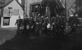 Assembled Territorials march from Drill Hall