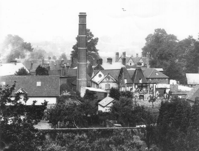 The doomed building was like a fiery furnace, from which the leaping flames threatened destruction to all the buildings around. Realising the serious situation, the Captain gave instructions for aid to be summoned from Sundridge and Sevenoaks. Having complete knowledge of the buildings, Mr. Watkins was able to point the Brigade to the most favourable positions from which to attack the fire; and his suggestions were speedily put into practice.  The greatest danger emanated from the Town side of the building, adjoining the old brewery malt kiln, and it was towards this spot that the firemen directed unrelenting zeal. Working from three hydrants on high pressure main, the brigade played on the fire with five branches. Fortunately an ample supply of water at tremendous pressure was available; but for a time the fire seemed to defy all efforts. While attention was directed to the Town end, the flames at the opposite end broke out with added vigour, and threatened Stakes Cottages.  The flames had reached the gable end of the nearest cottage; but well-directed jets of water drove back the menacing blaze. Efforts were again directed to saving the malt kiln, for it was realised that once this old building had become involved, the fire would have encompassed Mr Watkins' residence and neighbouring houses, with the inevitable result that they would have been burnt out. But to save the kiln from the ravages of the flames was an exceedingly difficult task, and in the hands of less determined and capable men would never have been accomplished. They spared no effort, and gradually checked the advance of the fire in this direction.  The heat was unbearable, but the intrepid firemen stuck to their duty unflinchingly until the fire was subdued. But this was not until six a.m., after five or six hours of the most trying and dangerous duty conceivable.The Combe Bank Fire Brigade and that of Sevenoaks having been summoned to help, arrived abut three-quarters of an hour from the call, but