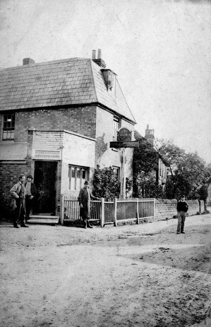 The Crown Beerhouse opposite New Street. A tied house to Reid & Co's brewery which would be absorbed into the Watney brewing empire in years to follow. This photograph dates from the late 1880s when Michael Wood took over from Henry Pope, beerhouse keeper and hairdresser. The notice above the door reads