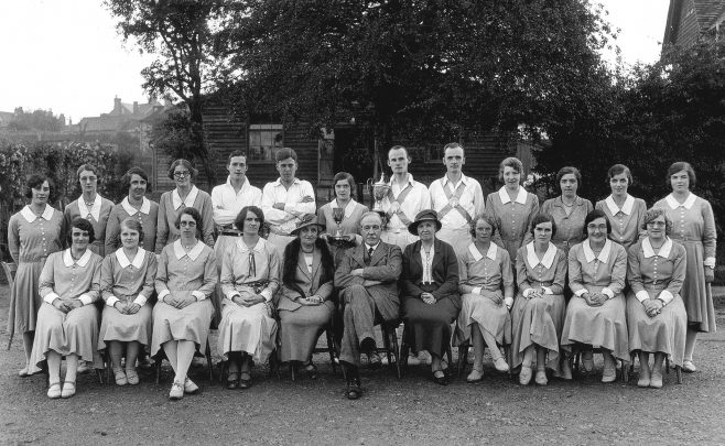John Hooker is in the back row, just off-centre holding the cup they had recently won