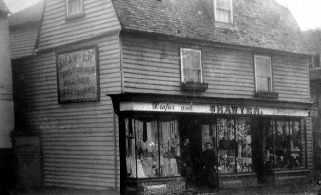In this photograph of 'London House' taken around 1905 we can see that the whole building was one business, not divided as it is today.  The young man and woman standing in the doorway are likely Charles Shawyer Junior and his sister Emily, who both worked for their father in this shop, the left-hand side of which is now Deli di Luca.