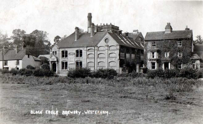 Near to the forge at Verralls Corner, this photograph taken from the opposite bank of the Long Pond, shows Spring Ardens, the Brewery frontage and 'Brewery House' the home of Ben Bushell, master brewer and proprietor of the Black Eagle Brewery until just before his death, aged 81 years, a year after the demise of his chief brewer, George Dadds.