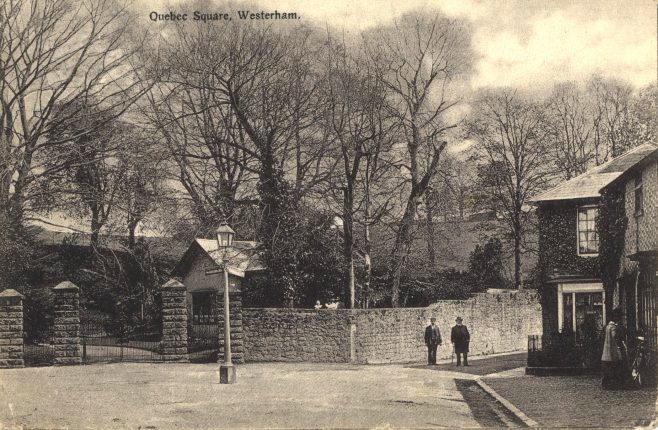 Dunsdale West Lodge in 1906 with the cast iron gates it still has today. These replaced earlier solid-oak gates which gave more privacy but lent a rather sombre air to the entrance. The lamppost and direction pointers stood in the middle of the square and traffic just drove around it. On the right can be seen 'Stakes' the home of William Finnis Watkins, owner of the Swan Brewery adjacent.