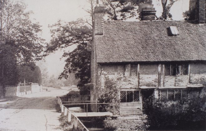 A closer shot of the end cottage of Springfields shows it to be timber framed with brick in-fill and of considerable antiquity.