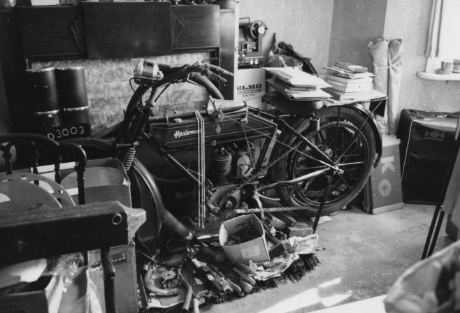 John retired early from his position as Chief Engineer at the telephone exchange due to ill health, but continued to buy and sell his motorcycles. In the early 1970s he began work on his pride and joy - a rare 1914 Hazlewood of which there were only three others known of in existence! He had originally purchased the machine in 1923 and had ridden it for a year before taking it apart to restore.   In the meantime, forty-four years of his life had crept by… By now living on his own at Merle Cottage, it was not surprising to those that knew him, that John's burgeoning collection of ephemera, memorabilia and old motorcycles filled not only his workshop, but most of the house too.