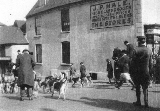 At that same location in 1915 a local fox-hunt were just returning after a successful morning, no doubt, over the park at Squerryes. They will make their way up Westerham Hill to the stables at South Street.