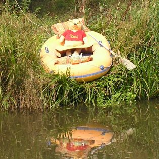Pooh Bear relaxes in his dinghy pulled up on the bank of the Long Pond, Sept 2007
