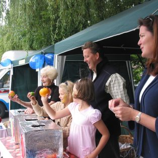 The Taylor Smith family and Dorothy Oram help to raise money for lifeboats with a Human Fruit Machine